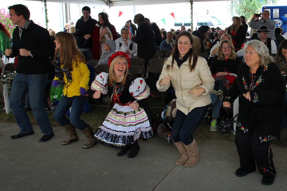 Photo - Festival patrons do the chicken dance during the 47th annual Czech Festival Saturday in Yukon. PHOTO BY HUGH SCOTT FOR THE OKLAHOMAN