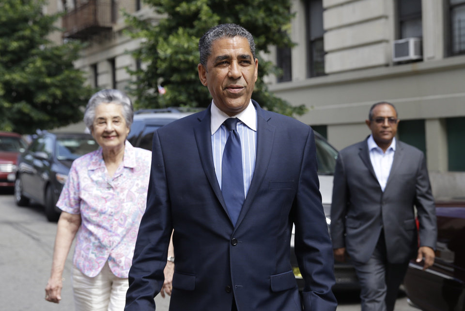 Photo - State Sen. Adriano Espaillat arrives at his polling station to vote in the congressional primaries, Tuesday, June 24, 2014, in New York. Espaillat, a Dominican-born legislator who lost by fewer than 1,100 votes in the 2012 primary, is challenging long-time Congressman Charles Rangel, on Tuesday, in the majority Hispanic district that includes Harlem. (AP Photo/Seth Wenig)