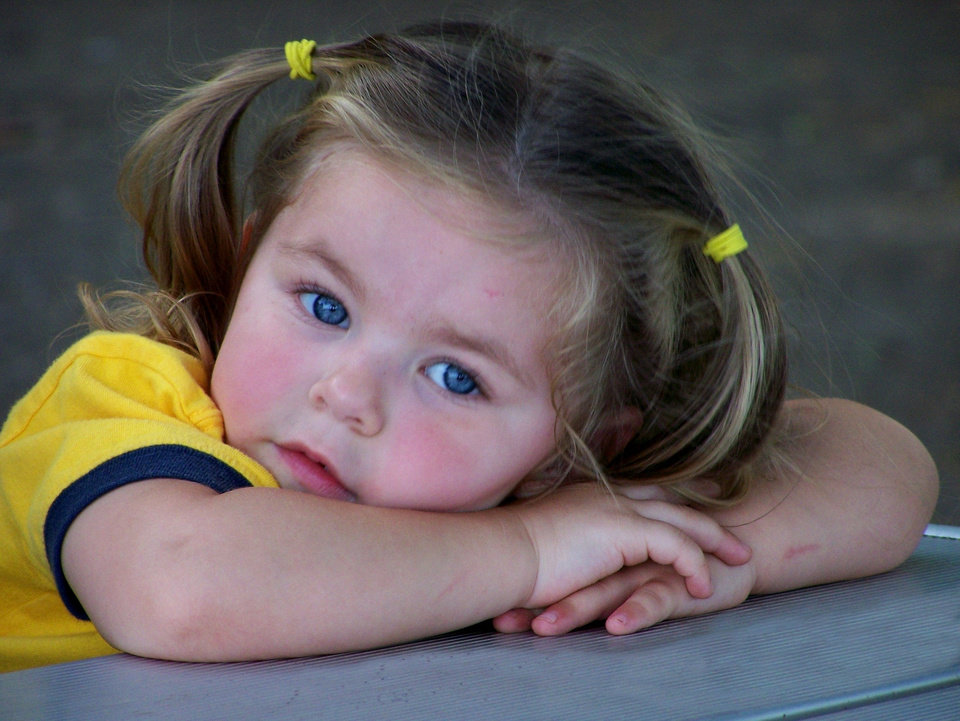 2 1/2 year old Lauren rests her head on her arms on a picnic table while taking a break at a local park.<br/><b>Community Photo By:</b> Darryl Goodman<br/><b>Submitted By:</b> Darryl, Warr Acres