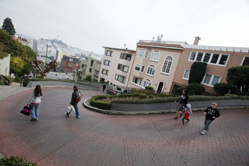 Photo - File - In this Feb. 4, 2009 file photo, tourists walk down Lombard Street, known as