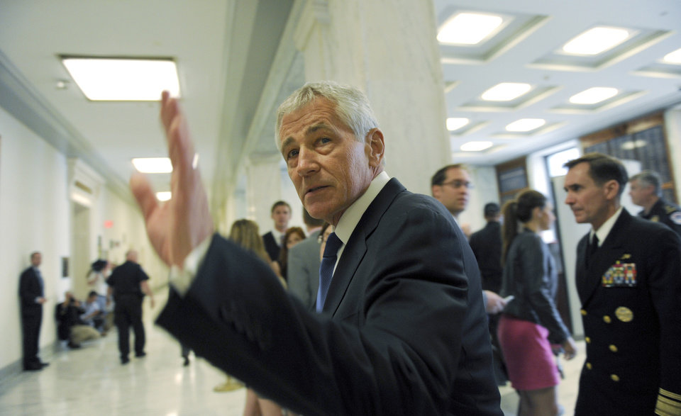 Photo - Defense Secretary Chuck Hagel arrives on Capitol Hill in Washington, Wednesday, June 11, 2014, to testify before the House Armed Services Committee. Hagel will face angry lawmakers as he becomes the first Obama administration official to testify publicly about the controversial prisoner swap with the Taliban.  (AP Photo/Susan Walsh)