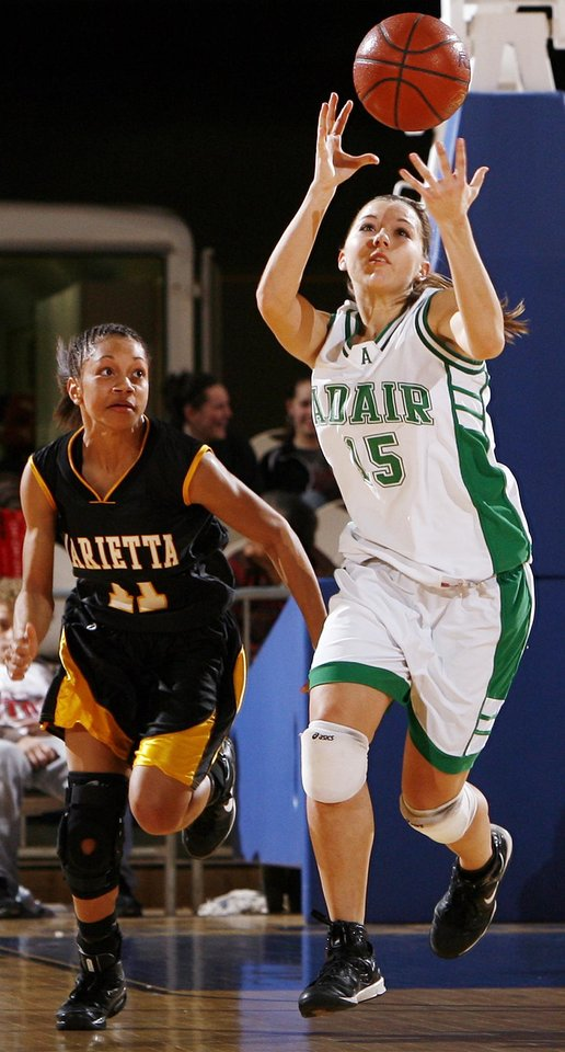 Photo - Adair's Kevi Luper (15) grabs the ball next to Marietta's Tanica Anderson (11) during the 3A girls semifinal game between Marietta and Adair in the Oklahoma High School Basketball Championships at State Fair Arena in Oklahoma City, Friday, March 13, 2009. Adair won, 55-50. PHOTO BY NATE BILLINGS, THE OKLAHOMAN