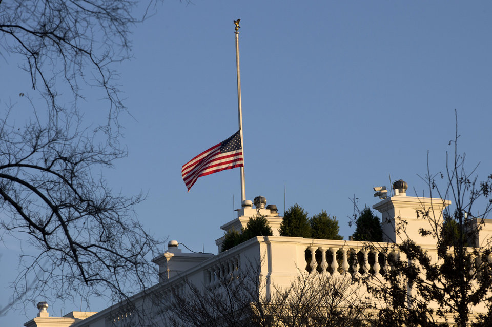 Photo - An American flag flies at half-staff over the White House in Washington, Friday, Dec. 14, 2012, in honor of the Connecticut elementary school shooting victims. (AP Photo/Charles Dharapak)