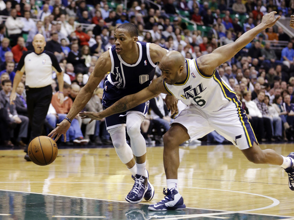 Oklahoma City Thunder's Russell Westbrook (0) drives to the basket as Utah Jazz's Jamaal Tinsley (6) defends in the first quarter of an NBA basketball game, Tuesday, Feb. 12, 2013, in Salt Lake City. (AP Photo/Rick Bowmer) ORG XMIT: UTRB101
