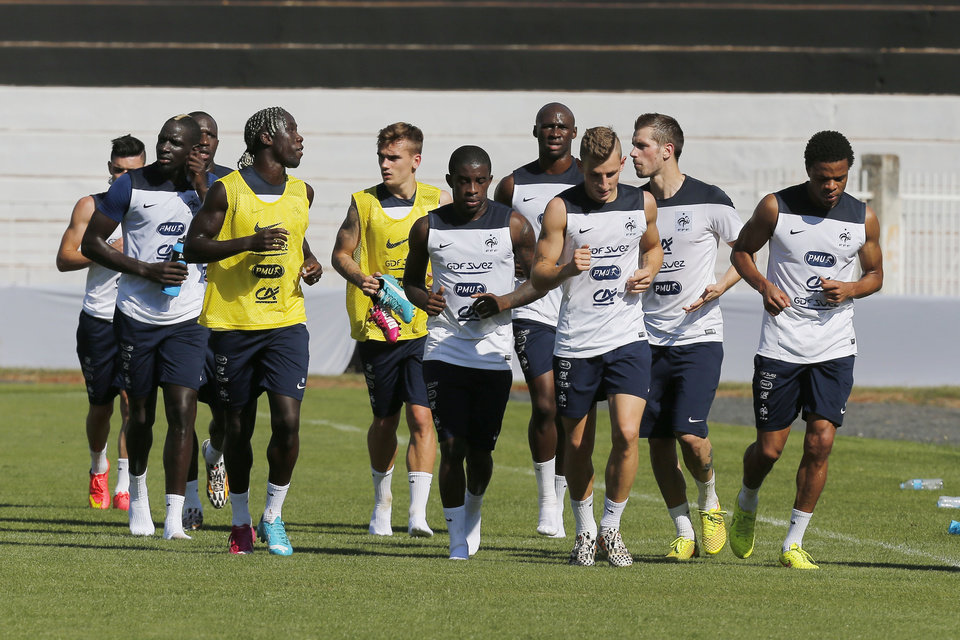 Photo - France's players train at the Santa Cruz stadium in Ribeirao Preto, Brazil, Tuesday, July 1, 2014. France will face Germany at a World Cup quarterfinal soccer match on Friday. (AP Photo/David Vincent)