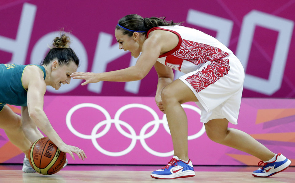 Photo - Australia's Jennifer Screen, left, and Russia's Becky Hammon, right, chase a loose ball during a preliminary women's basketball game at the 2012 Summer Olympics, Friday, Aug. 3, 2012, in London. (AP Photo/Eric Gay)