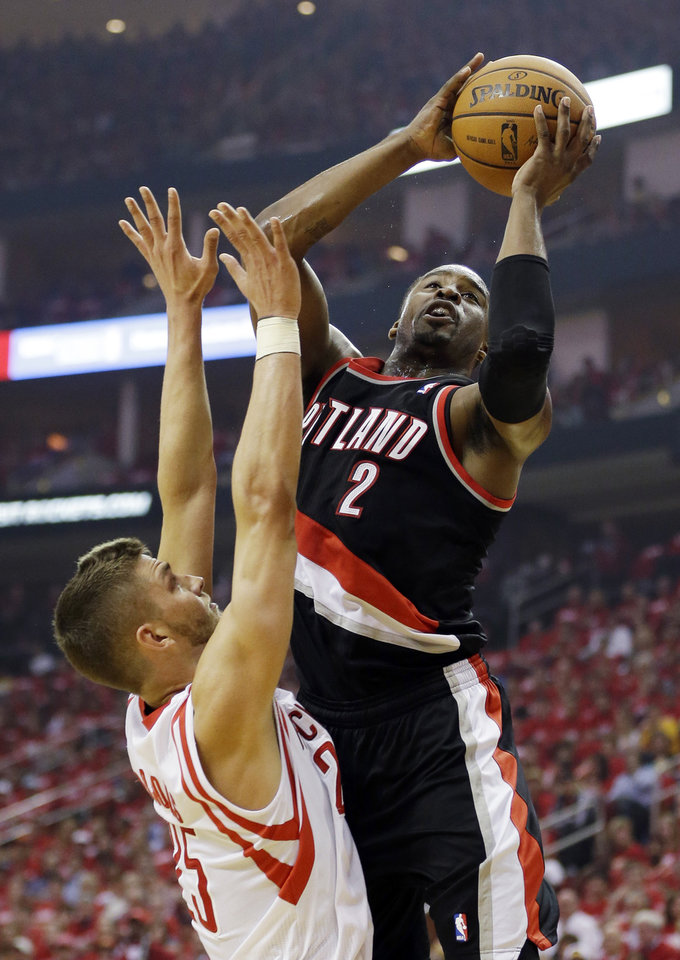 Photo - Portland Trail Blazers' Wesley Matthews (2) shoots over Houston Rockets' Chandler Parsons during the first half in Game 1 of an opening-round NBA basketball playoff series, Sunday, April 20, 2014, in Houston. (AP Photo/David J. Phillip)