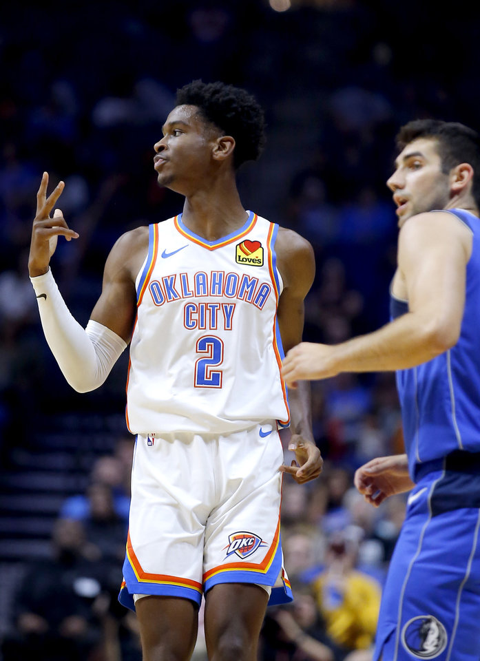 Photo - Oklahoma City's Shai Gilgeous-Alexander (2) reacts after a basket during the preseason NBA game between the Oklahoma City Thunder and the Dallas Mavericks at the BOK Center in Tulsa, Okla. , Tuesday, Oct. 8, 2019. [Sarah Phipps/The Oklahoman]