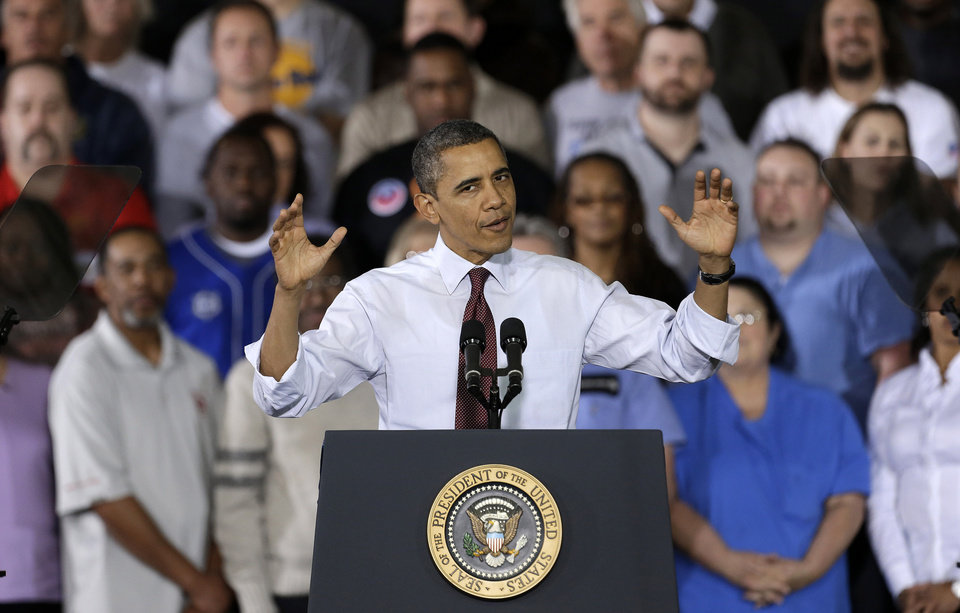 Photo - President Barack Obama gestures as he speaks to workers about the economy during a visit to Daimler Detroit Diesel in Redford, Mich., Monday, Dec. 10, 2012.  (AP Photo/Paul Sancya)