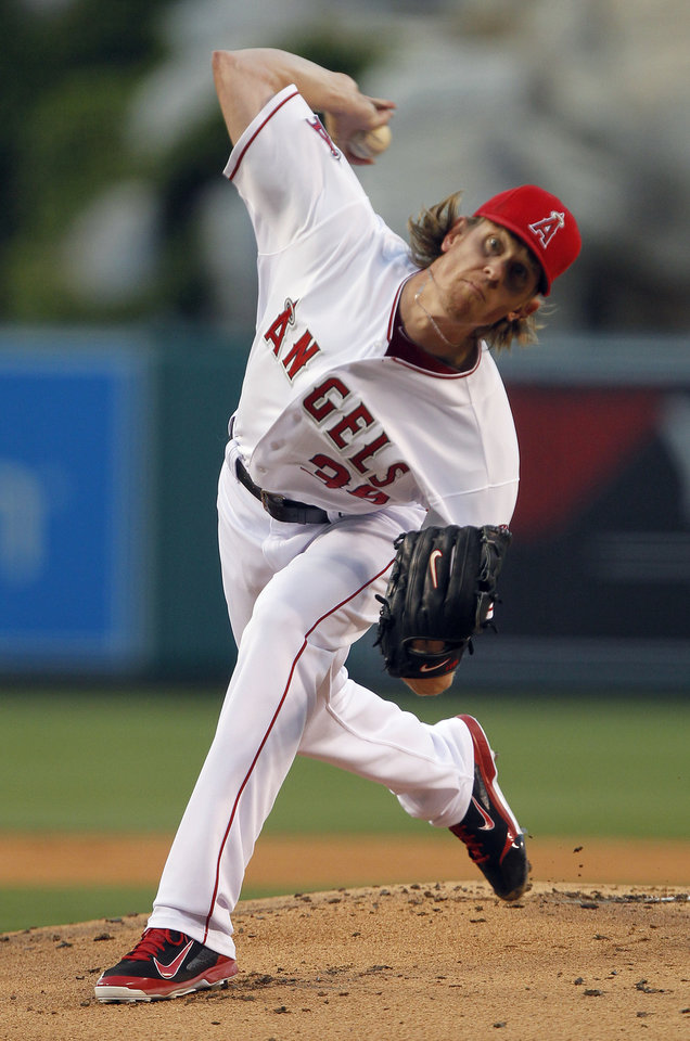 Photo - Los Angeles Angels starting pitcher Jered Weaver throws to the Cleveland Indians in the first inning of a baseball game Tuesday, April 29, 2014, in Anaheim, Calif. (AP Photo/Alex Gallardo)