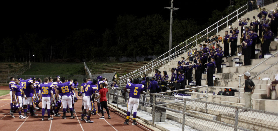 The NWC players gather in front of the band for the playing of the Alma Mater after the game at the Northwest Classen vs. Western Heights high school football game at Taft Stadium Thursday, September 20, 2012. Photo by Doug Hoke, The Oklahoman