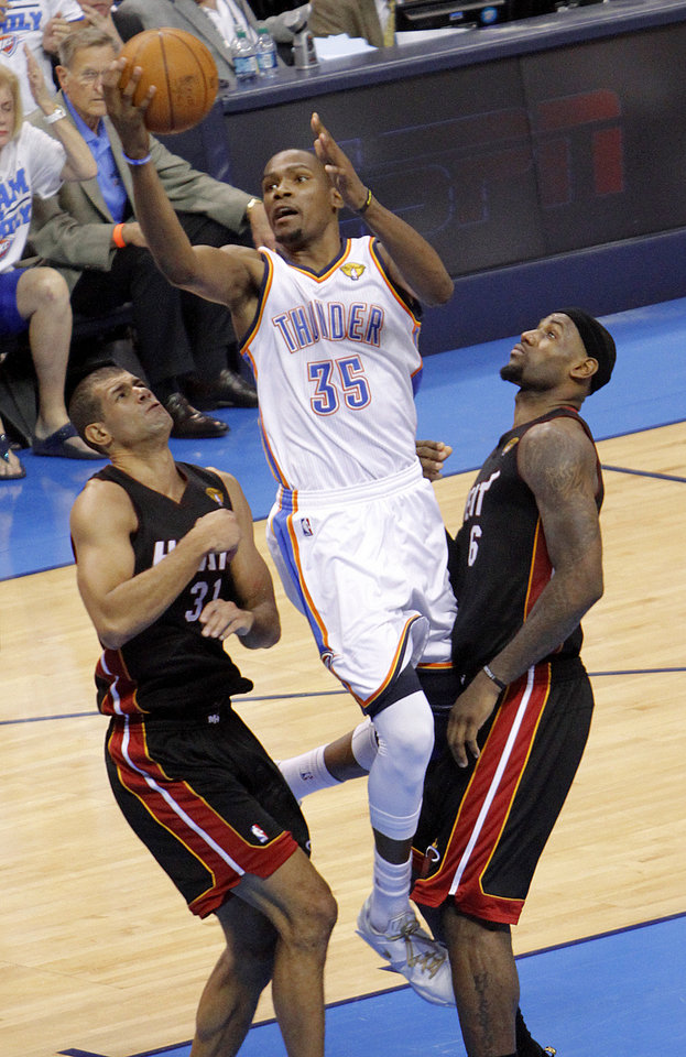 Photo - Oklahoma City's Kevin Durant (35) goes between Miami's Shane Battier (31), and Miami's LeBron James (6) during Game 2 of the NBA Finals between the Oklahoma City Thunder and the Miami Heat at Chesapeake Energy Arena in Oklahoma City, Thursday, June 14, 2012. Photo by Chris Landsberger, The Oklahoman