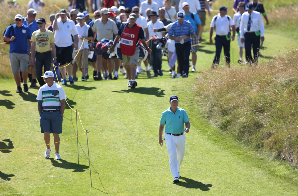 Photo - Tom Watson of the US walks up to the 13th green during the first day of the British Open Golf championship at the Royal Liverpool golf club, Hoylake, England, Thursday July 17, 2014. (AP Photo/Scott Heppell)
