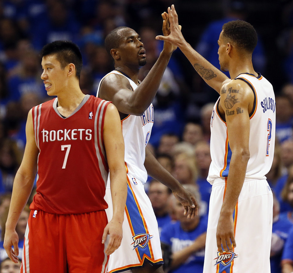 Oklahoma City\'s Serge Ibaka and Thabo Sefolosha (2) high-five near Houston\'s Jeremy Lin (7) after Ibaka made a shot and was fouled during Game 1 in the first round of the NBA playoffs between the Oklahoma City Thunder and the Houston Rockets at Chesapeake Energy Arena in Oklahoma City, Sunday, April 21, 2013. Photo by Nate Billings, The Oklahoman