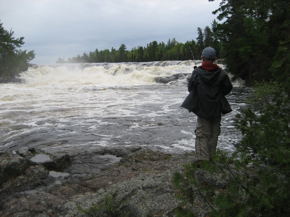 Photo - Declan Lawson, 10, of Moore fishes below Curtain Falls in the Boundary Waters Canoe Area Wilderness of northern Minnesota. Photo by Jim Lawson