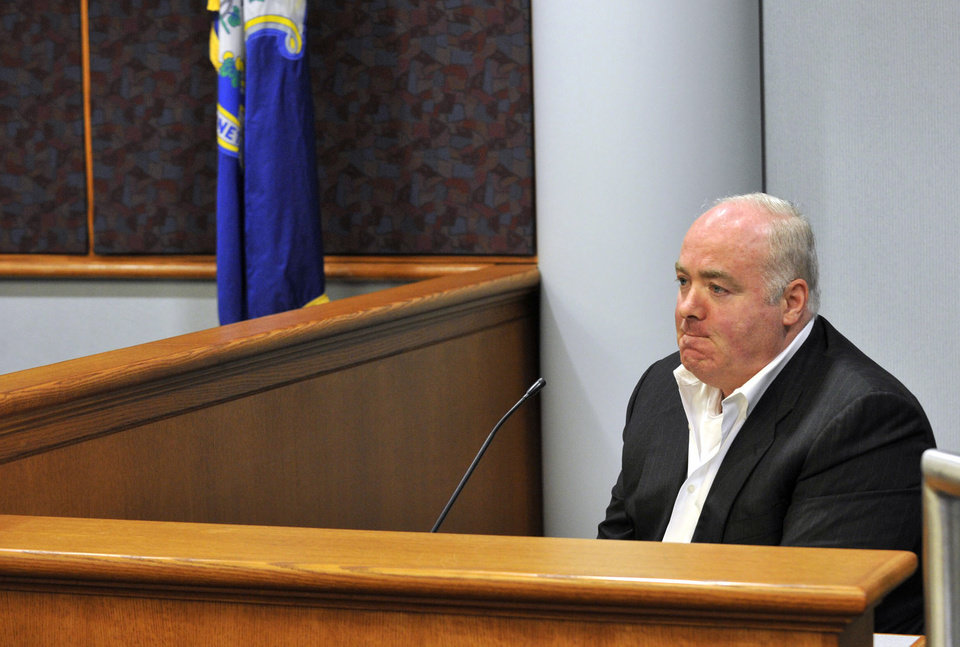 Photo - Michael Skakel testifies during his appeal trial at Rockville Superior Court in Vernon, Conn., on Thursday, April 25, 2013.   Skakel launched a barrage of criticism Thursday against the attorney who represented him at his murder trial, saying he failed to track down key witnesses while having fun and basking in the limelight.  Skakel is serving 20 years to life in prison for the 1975 golf club bludgeoning of Martha Moxley in Greenwich when they were both 15 years old. Skakel argues trial attorney Michael Sherman got caught up in the limelight of the high-profile case and failed to prepare. (AP Photo/The Stamford Advocate, Jason Rearick, Pool)