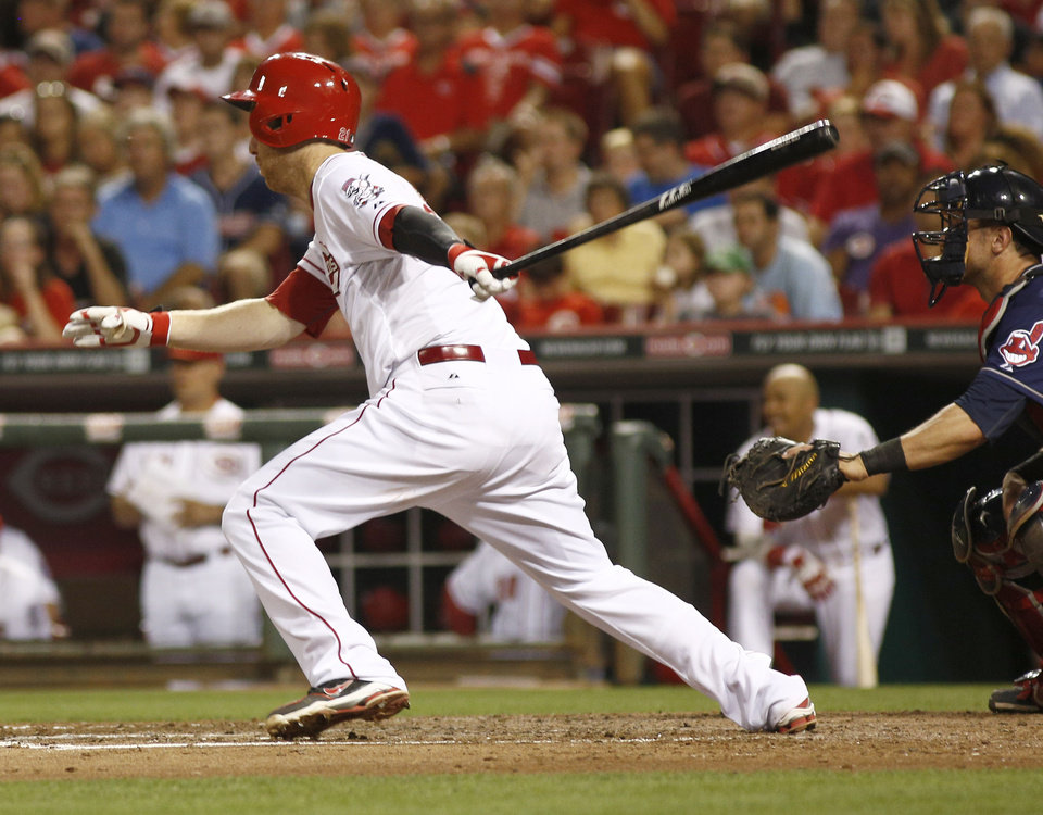 Photo - Cincinnati Reds' Todd Frazier hits a two-run double off Cleveland Indians relief pitcher Marc Rzepczynski in the seventh inning of a baseball game, Wednesday, Aug. 6, 2014, in Cincinnati. The Reds won 8-3. (AP Photo/David Kohl)