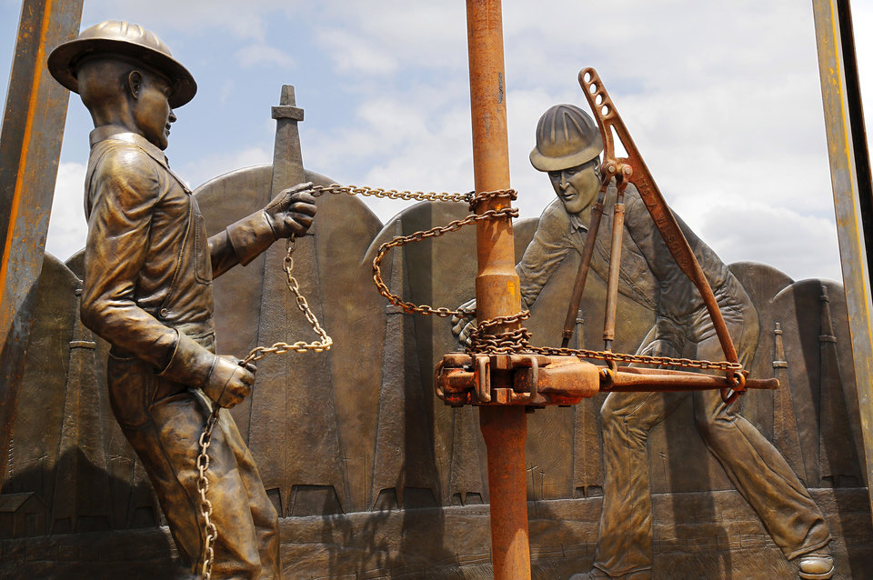 """Photo -  Edmond's newest public art piece, """"West Edmond Oil Field,"""" is outside the Mitch Park YMCA and Edmond Competitive Pool in J.L. Mitch Park. Photo by Jim Beckel, The Oklahoman   Jim Beckel -"""
