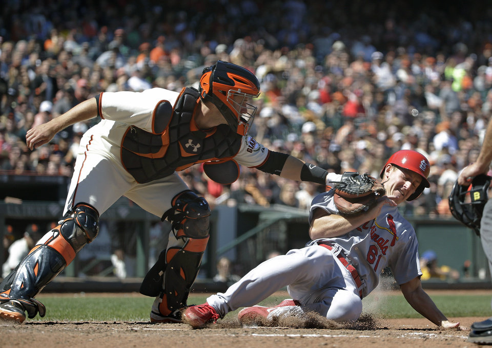 Photo - St. Louis Cardinals' Seth Maness, right, is tagged out at home plate by San Francisco Giants catcher Buster Posey, left, in the eighth inning of their baseball game Thursday, July 3, 2014, in San Francisco. Maness was trying to score from third base after the Cardinals' Jhonny Peralta lined into a double play to Giants left fielder Tyler Colvin. (AP Photo/Eric Risberg)
