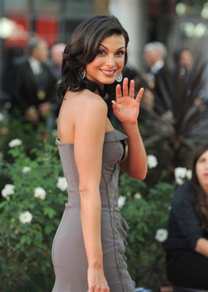 Photo - Actress Morena Baccarin arrives at the 64th Primetime Emmy Awards at the Nokia Theatre on Sunday, Sept. 23, 2012, in Los Angeles.  (Photo by Jordan Strauss/Invision/AP)