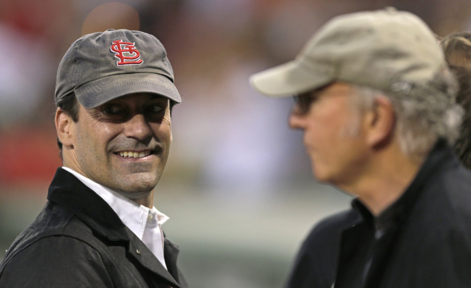 Photo -   Actors Jon Hamm, left, and Larry David talk prior to a baseball game between the New York Yankees and the Boston Red Sox, Thursday, Sept. 13, 2012 at Fenway Park in Boston. (AP Photo/Charles Krupa)