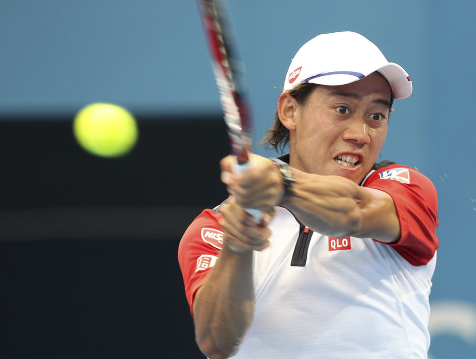 Photo - Kei Nishikori of Japan plays a shot in his quarter final match against Marin Cilic of Croatia during the Brisbane International tennis tournament in Brisbane, Australia, Friday, Jan. 3, 2014. (AP Photo/Tertius Pickard)