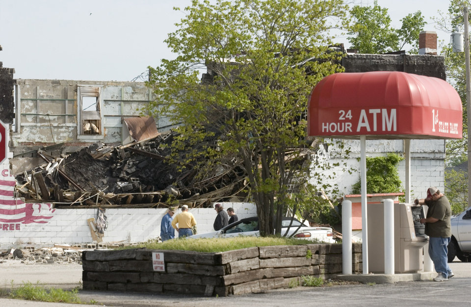 Many of the buildings in downtown Picher have been abandoned, and an historical building used for storage the past 20 years collapsed Sunday night, but signs of life this morning included a man using a bank ATM. Photo by Gary Crow, for The Oklahoman
