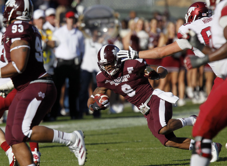 Photo -   Mississippi State defensive back Darius Slay (9) loses his balance as he runs back a fourth quarter interception for 15-yards against Arkansas in an NCAA college football game in Starkville, Miss., Saturday, Nov. 17, 2012. Mississippi State won 45-14. (AP Photo/Rogelio V. Solis)