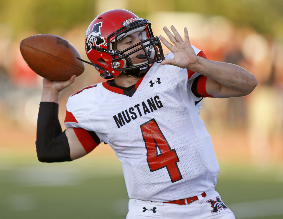 Mustang's Frankie Edwards throws a pass during a high school football game against Yukon in Yukon, Okla., Friday, August 31, 2012. Photo by Bryan Terry, The Oklahoman