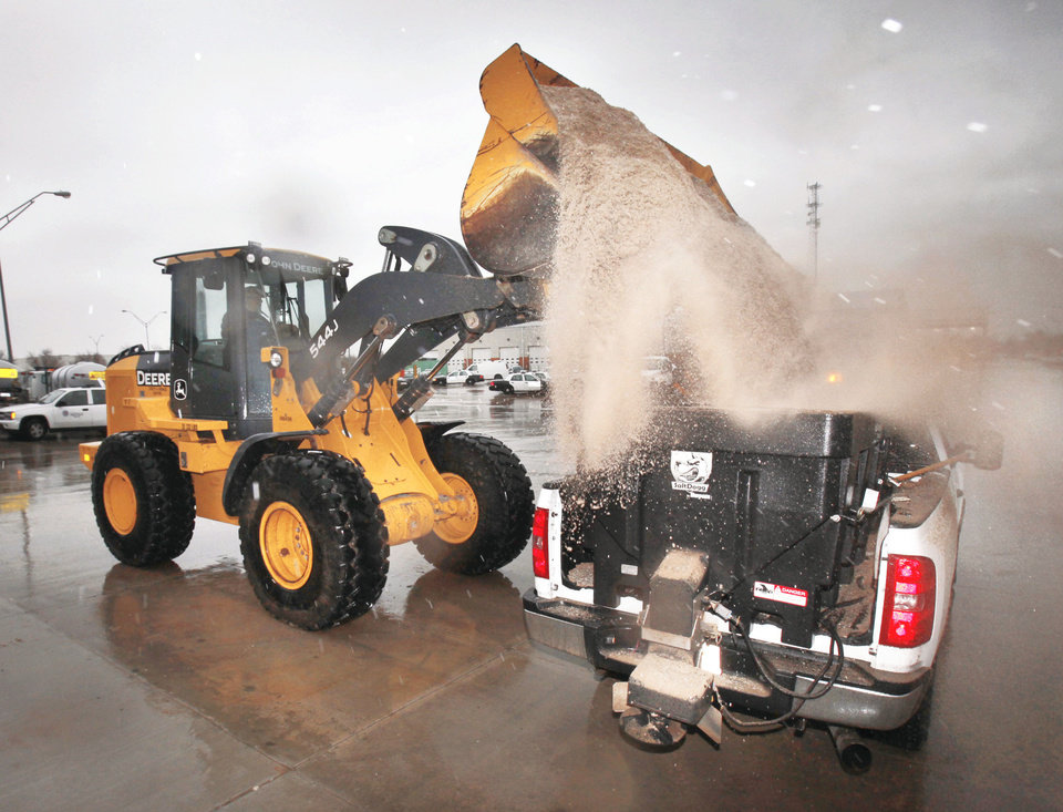 Photo - An Oklahoma City truck is loaded with salt Thursday at the Central Maintenance Facility.  PHOTO BY PAUL HELLSTERN, THE OKLAHOMAN