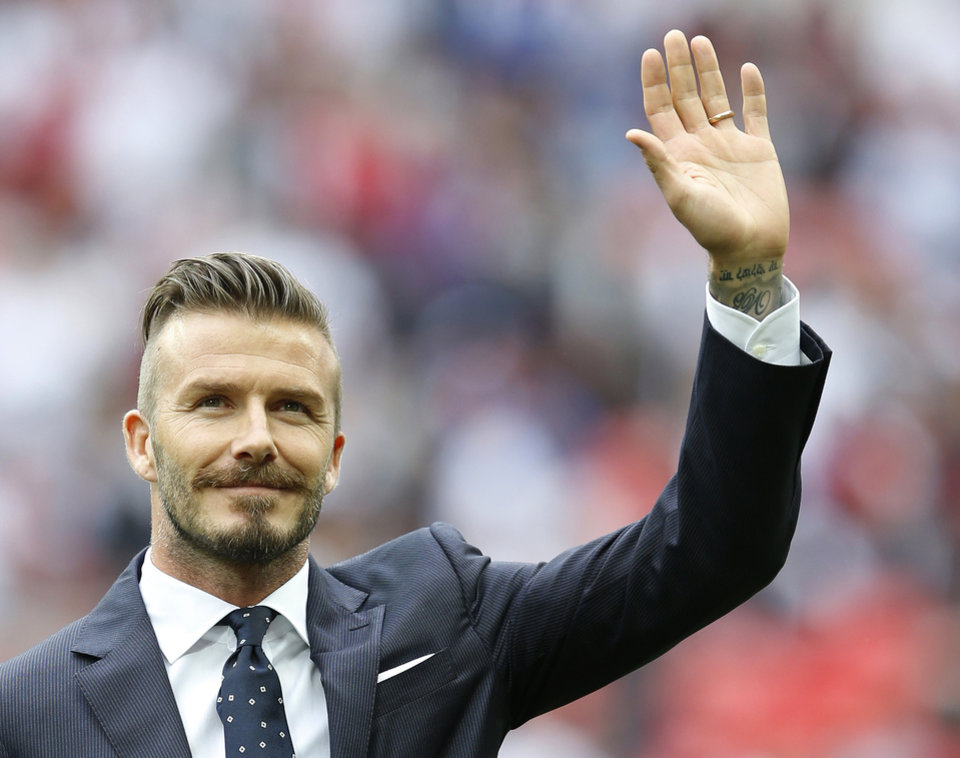 Photo -  FILE This Saturday, June 2, 2012 file photo shows England's David Beckham in a special half-time ceremony to honor the five players that have played for England over 100 times each during the international friendly soccer match between England and Belgium at Wembley Stadium in London. Former England captain David Beckham has failed to make the British football team for the London Olympics. The Los Angeles Galaxy midfielder made Britain coach Stuart Pearce's shortlist of 35 but wasn't selected for the final 18-man squad as one of three players over the age of 23 allowed to compete in the games.