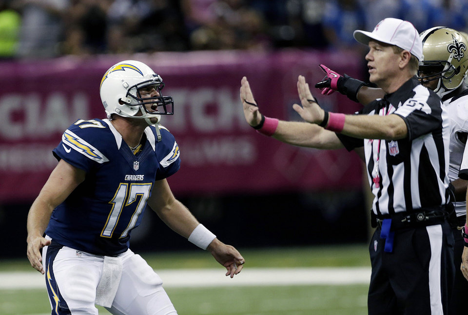 Photo -   San Diego Chargers quarterback Philip Rivers (17) reacts to an official's offensive pass interference call in the second half of an NFL football game against the New Orleans Saints at Mercedes-Benz Superdome in New Orleans, Sunday, Oct. 7, 2012. (AP Photo/Dave Martin)
