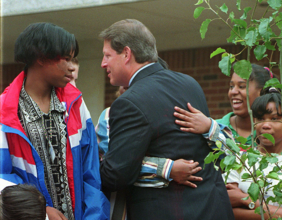 Photo - CI Vice President Al Gore talks with Kenisha Paxton while hugging another student at Webster Middle School in okla. City. Kenisha is a twelve year-old sixth grader at Webster.  At right is the tree they just planted as a memorial to victims of the Alfred Murrah Federal Building car bomb explosion.
