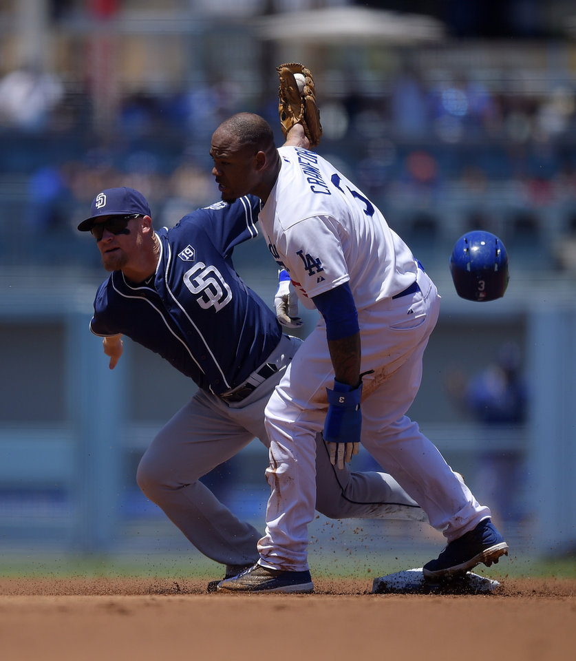 Photo - Los Angeles Dodgers' Carl Crawford, right, steals second as San Diego Padres second baseman Brooks Conrad takes a late throw from home during the first inning of a baseball game, Sunday, July 13, 2014, in Los Angeles. (AP Photo/Mark J. Terrill)