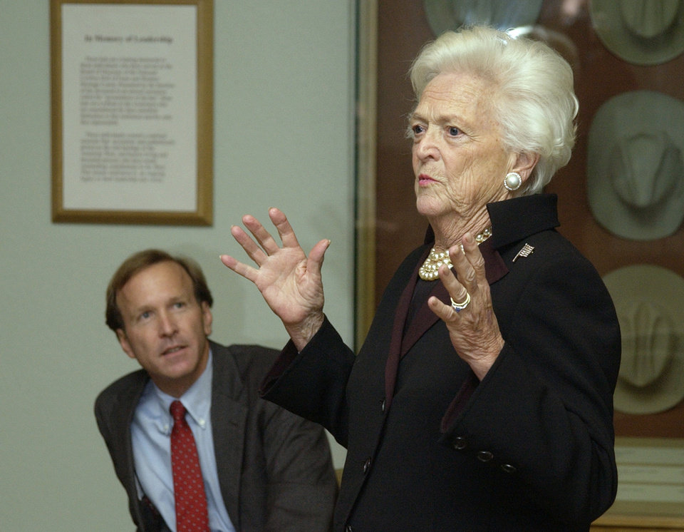 Photo - Oklahoma City, OK. 1/19/04 Former First Lady Barbara Bush and son Neil Bush speak to people at a reception at the National Cowboy and Western Heritage Museum as part of a literacy awareness program for local schools. Staff photo by Paul Hellstern