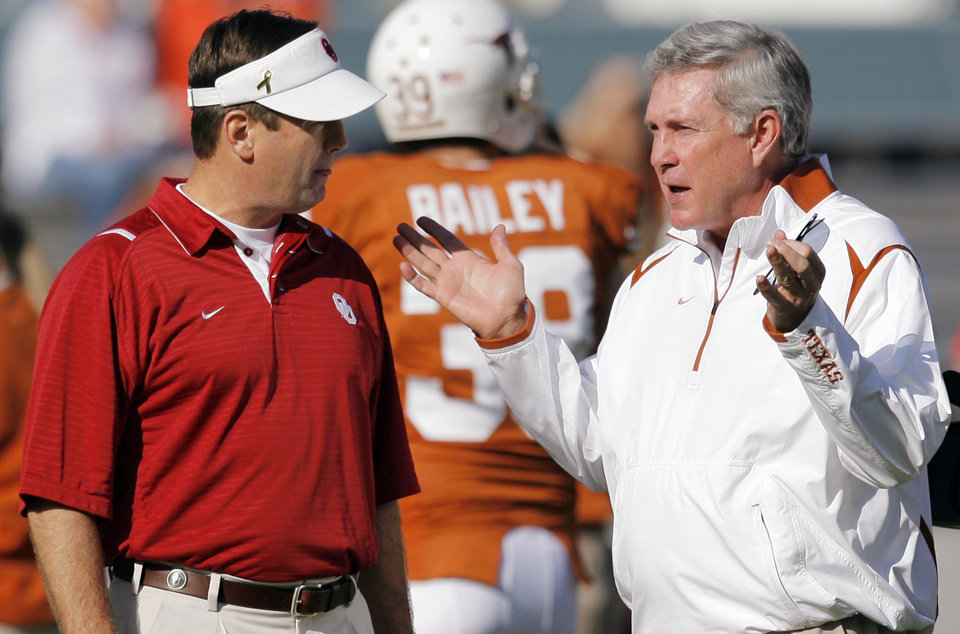 Photo - OU head coach Bob Stoops, left, and Texas head coach Mack Brown talk before the Red River Rivalry college football game between the University of Oklahoma Sooners (OU) and the University of Texas Longhorns (UT) at the Cotton Bowl in Dallas, Texas, Saturday, Oct. 17, 2009. Photo by Nate Billings, The Oklahoman ORG XMIT: KOD
