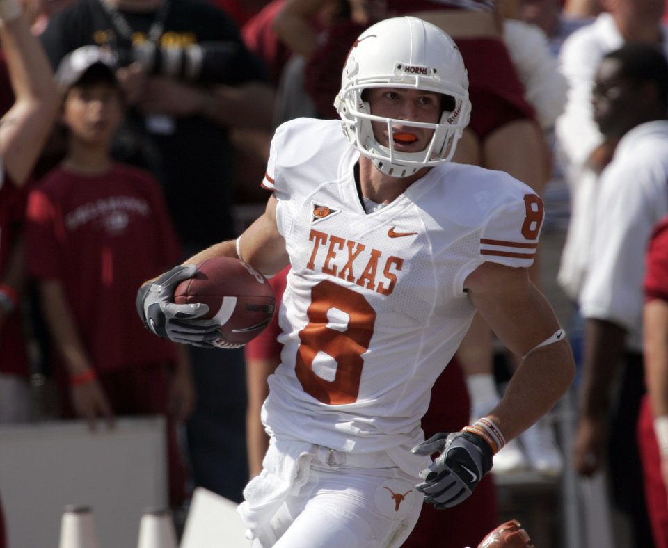 Photo - OU: University of Texas wide receiver Jordan Shipley (8) scores a touchdown after returning a kick off from University of Oklahoma for 96 yards in the second quarter of an NCAA college football game, Saturday, Oct. 11, 2008, in Dallas. (AP Photo/Donna McWilliam) ORG XMIT: DNB112