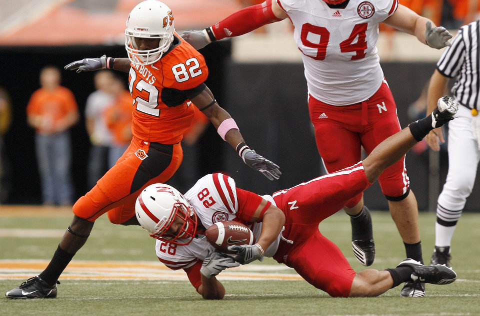 Nebraska's Eric Hagg (28) interepts a pass in front of OSU's Isaiah Anderson during the college football game between the Oklahoma State Cowboys (OSU) and the Nebraska Huskers (NU) at Boone Pickens Stadium in Stillwater, Okla., Saturday, Oct. 23, 2010. Photo by Sarah Phipps, The Oklahoman