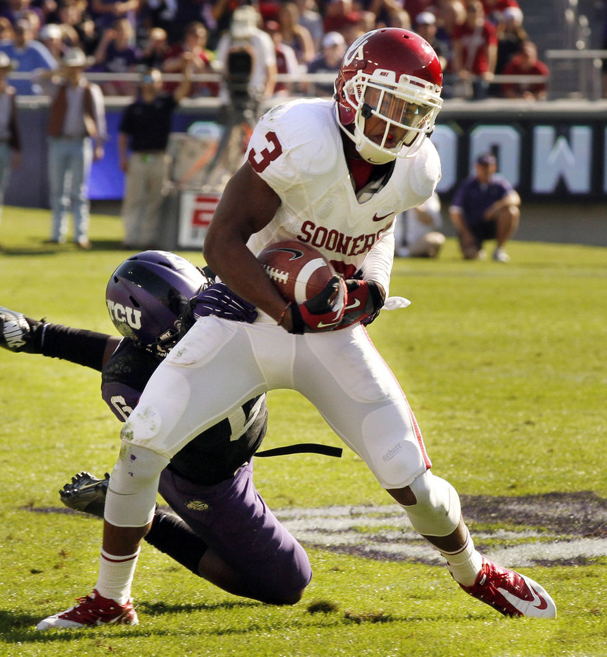 Oklahoma's Sterling Shepard (3) catches a pass in front of TCU's Elisha Olabode (6) during the second half of the college football game where the University of Oklahoma Sooners (OU) defeated the Texas Christian University Horned Frogs (TCU) 24-17 at Amon G. Carter Stadium in Fort Worth, Texas, on Saturday, Dec. 1, 2012. Photo by Steve Sisney, The Oklahoman