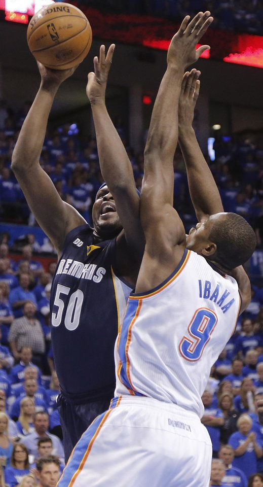Photo - Memphis' Zach Randolph (50) shoots over Oklahoma City's Serge Ibaka (9) during the second round NBA playoff basketball game between the Oklahoma City Thunder and the Memphis Grizzlies at Chesapeake Energy Arena in Oklahoma City, Sunday, May 5, 2013. Photo by Chris Landsberger, The Oklahoman