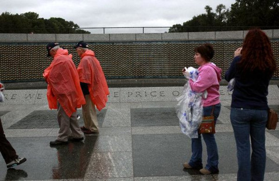 "Veterans and tourists walk past a section of the National WWII Memorial called The Price of Freedom in Washington D.C. on Wednesday Oct. 12, 2011. A plaque near the exhibit reads 'The Freedom Wall holds 4,048 gold stars. Each gold star represents one hundred American service personnel who died or remain missing in the war. The 405,399 American dead and missing from World War II are second only to the loss of more than 620,000 Americans during our Civil War."" Veterans from Oklahoma visited the National WWII Memorial during an Oklahoma Honor Flight to Virginia and Washington D.C. on Wednesday, Oct. 12, 2011. Photo by John Clanton, The Oklahoman ORG XMIT: KOD"