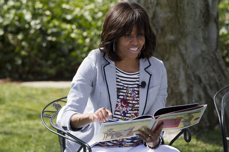 Photo - First lady Michelle Obama reads the book
