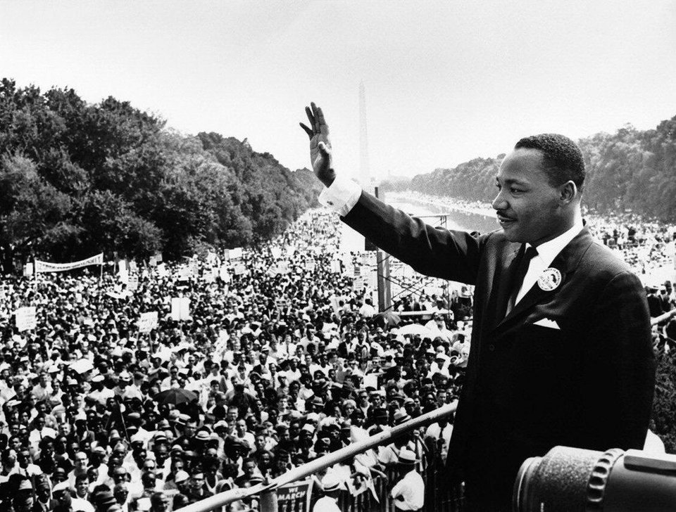 "In this Aug. 28, 1963, file photo, the Rev. Martin Luther King Jr. waves to the crowd at the Lincoln Memorial for his ""I Have a Dream"" speech during the March on Washington. The march was organized to support proposed civil rights legislation and end segregation. AP Photo"