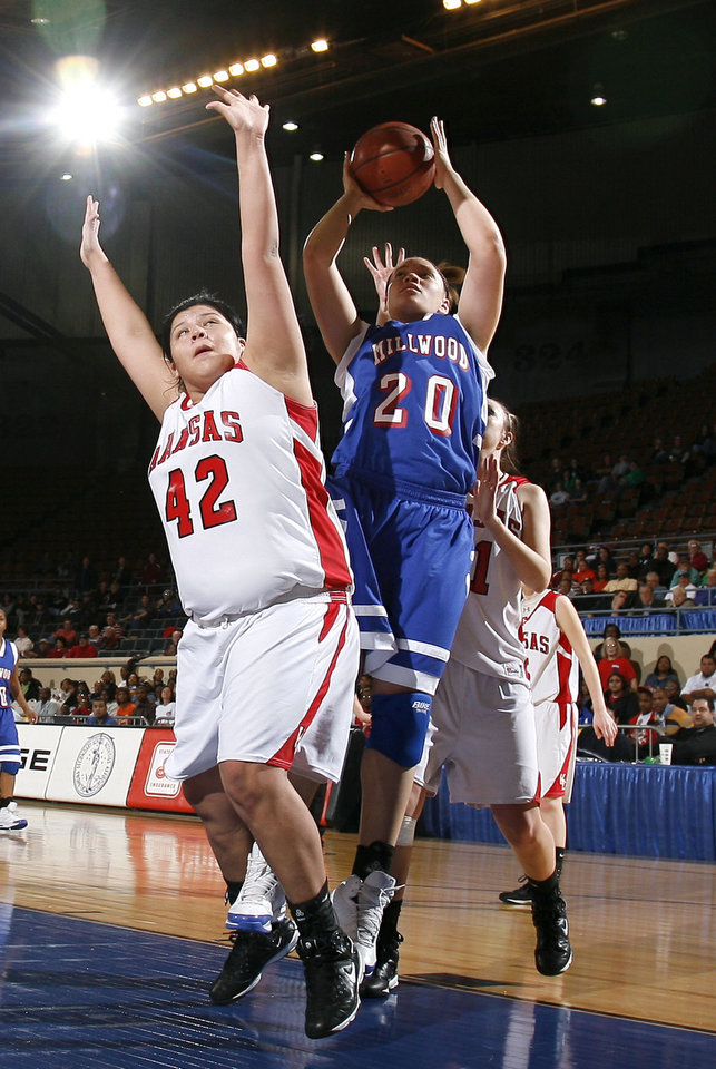 Photo - Kansas' Brooke Panther (42) and Marisha Wallace (20) fight for a rebound during the girls 3A semifinal between MIillwood and Kansas at the State Fair Arena, Friday, March 13, 2009, in Oklahoma City. PHOTO BY SARAH PHIPPS, THE OKLAHOMAN