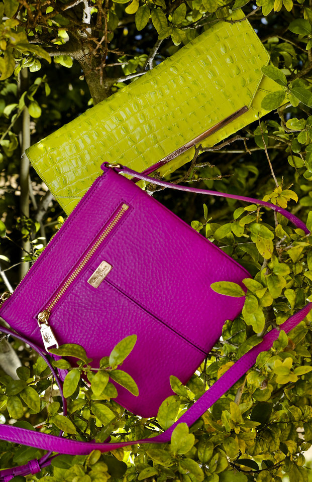 Cole Haan purple cross body bag, Brahmin embossed neon clutch and Tres Vero mint satchel, available at Dillard's, Penn Square Mall.  <strong>CHRIS LANDSBERGER</strong>