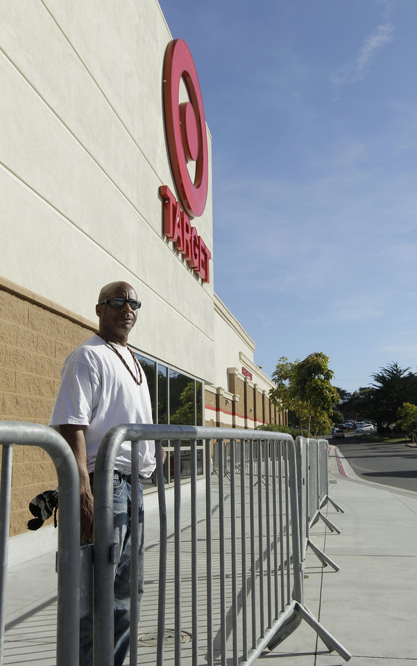 Photo -   Michael Walsh waits in in line at a Target store in Colma, Calif., Thursday, Nov. 22, 2012. Walsh was the first person in line, showing up at about 6am Thursday morning. Stores typically open in the wee hours of the morning on the day after Thanksgiving known as Black Friday, named for the period when stores traditionally turn a profit for the year. But Black Friday openings have crept earlier and earlier over the past few years. Now, stores from Wal-Mart to Toys R Us are opening their doors on Thanksgiving evening, hoping Americans will be willing to shop soon after they finish their pumpkin pie. (AP Photo/Jeff Chiu)