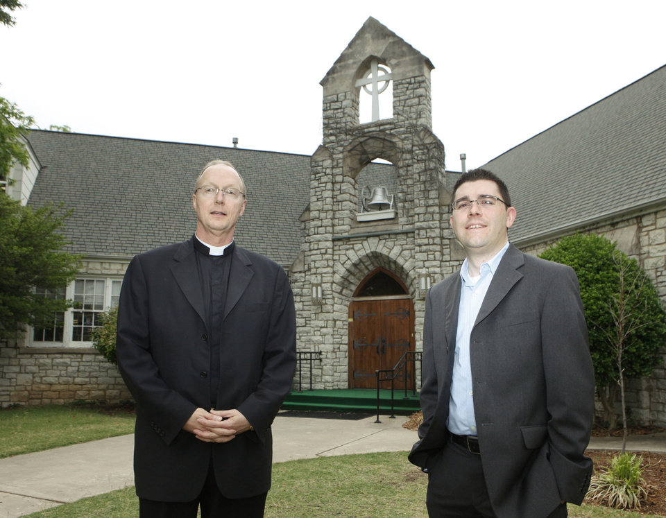 In this 2010 photo, the Rev. Richard Stansberry, pastor of Christ the KIng Catholic Church, and the Rev. Tim Blodgett stand in front of Greystone Presbyterian Church in Nichols Hills, before the Presbyterian church was purchased by the neighboring Catholic church and demolished to make way for school expansion. <strong>PAUL HELLSTERN</strong>