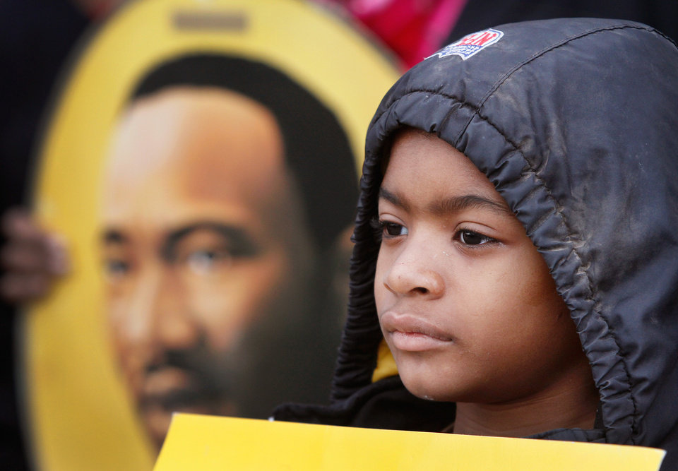 Shane Byrd, 9, stands next to his mother, Rev. Christina Byrd , as she speaks to a crowd in front of the Freedom Center at one of several events in the Oklahoma City area that allowed local residents to observe the national holiday honoring slain civil rights leader, Dr. Rev. Martin Luther King, Jr. on Monday, Jan. 16, 2012, Photo by Jim Beckel, The Oklahoman