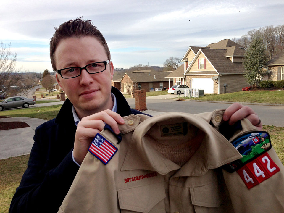 Photo - In this Monday, Feb. 4, 2013 photo provided by the family, Wes Comer holds the Boy Scout uniform of his son, Isaiah, outside their home in Knoxville, Tenn. Comer, his wife and children belong to an Apostolic Pentecostal church that considers homosexuality sinful. Comer says he will pull his eldest son out of the Scouts, despite a positive experience with them, if the BSA modifies the policy to allow some troops to accept gays. (AP Photo/Brooke Comer)