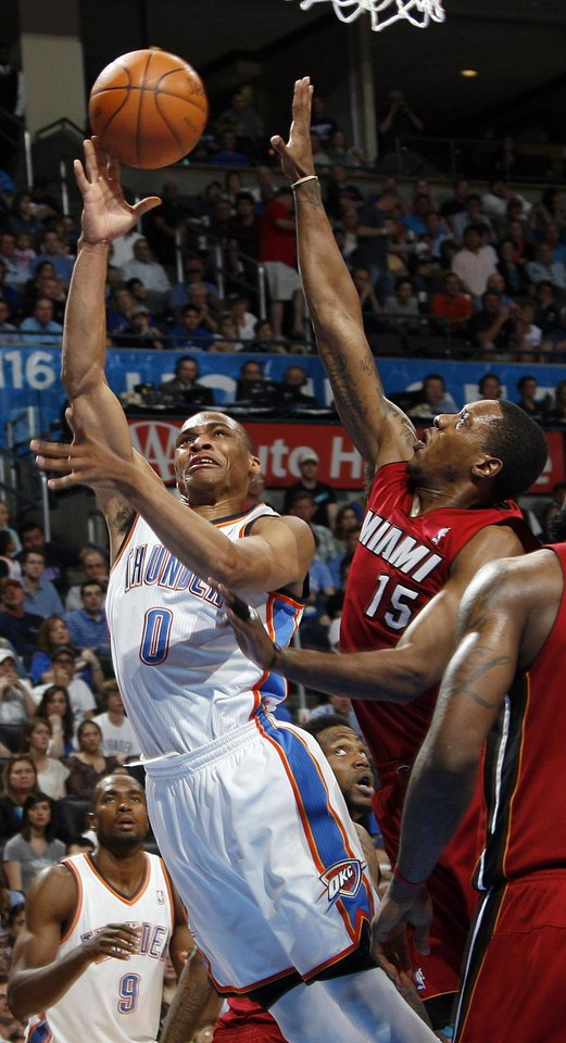 Photo - Oklahoma City's Russell Westbrook (0) moves to the hoop in front of Miami's Mario Chalmers (15) during the NBA basketball game between the Miami Heat and the Oklahoma City Thunder at Chesapeake Energy Arena in Oklahoma City, Sunday, March 25, 2012. Oklahoma City won, 103-87. Photo by Nate Billings, The Oklahoman